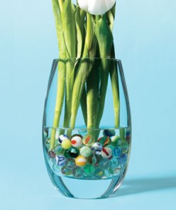 Add marbles to the bottom of a vase to keep your daisies in the drink and make arranging, well, child's play.