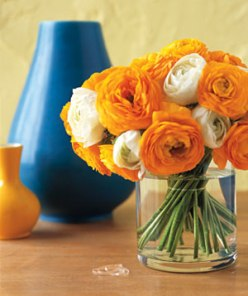 To keep all types of flowers in place in a wide-mouth vase, stretch a clear hair elastic around the stems, then let the flowers fall naturally. Your beautiful blooms will be styled in a snap.