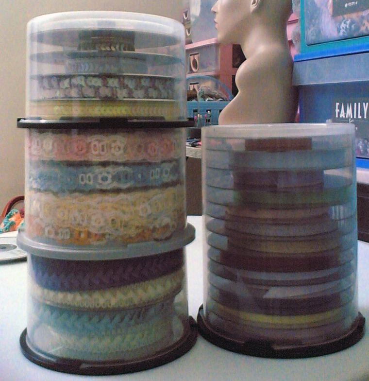 CD containers are good way to store your lace and ribbon samples, don't forget to slide a CD between layers.